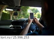 Купить «Man using mobile phone in car», фото № 25996253, снято 3 февраля 2017 г. (c) Wavebreak Media / Фотобанк Лори
