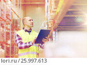 Купить «man with clipboard in safety vest at warehouse», фото № 25997613, снято 9 декабря 2015 г. (c) Syda Productions / Фотобанк Лори