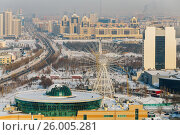Купить «Mega Center Astana and the Ferris wheel on the left bank of Astana, Kazakhstan», фото № 26005281, снято 27 июня 2019 г. (c) Андрей Орехов / Фотобанк Лори