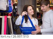 Купить «Couple looking at stylish female handbags in store», фото № 26007513, снято 9 февраля 2016 г. (c) Татьяна Яцевич / Фотобанк Лори