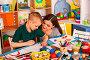 Small students girl and boy painting in art school class., фото № 26007585, снято 25 марта 2017 г. (c) Gennadiy Poznyakov / Фотобанк Лори