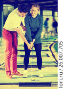 Купить «Golf trainer teaches a woman game», фото № 26007705, снято 17 ноября 2018 г. (c) Яков Филимонов / Фотобанк Лори