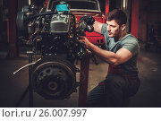 Mechanic working on classic car engine in restoration workshop, фото № 26007997, снято 6 апреля 2017 г. (c) Andrejs Pidjass / Фотобанк Лори