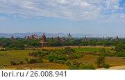 Купить «Landscape with Temples in Bagan, Myanmar», видеоролик № 26008941, снято 3 апреля 2016 г. (c) Михаил Коханчиков / Фотобанк Лори