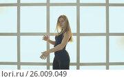 Купить «Beauty Teenage Girl Dancing dance dolls or robots. Against the background of a window in the form of a cage, cubes and squares. Joyful Teen Girl. Slow motion.», видеоролик № 26009049, снято 14 апреля 2017 г. (c) Mikhail Davidovich / Фотобанк Лори