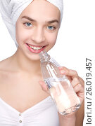 Young woman with towel and bottle of water. Стоковое фото, фотограф Tatjana Romanova / Фотобанк Лори