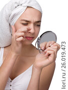Купить «Close-up of teenager finding an acne on her nose», фото № 26019473, снято 24 марта 2012 г. (c) Tatjana Romanova / Фотобанк Лори