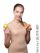Купить «Girl with piece of pizza and green apple», фото № 26019481, снято 24 марта 2012 г. (c) Tatjana Romanova / Фотобанк Лори