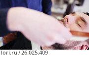 Купить «barber cleaning male face with brush at shop», видеоролик № 26025409, снято 27 июня 2019 г. (c) Syda Productions / Фотобанк Лори