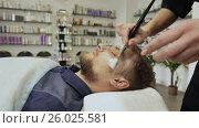 Купить «Applying cream-mask. Bearded man. Massage the face and neck.», видеоролик № 26025581, снято 21 марта 2017 г. (c) Mikhail Davidovich / Фотобанк Лори