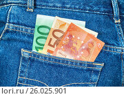 Euro banknotes sticking out of the back jeans pocket. Money for travel and shopping, фото № 26025901, снято 21 апреля 2017 г. (c) FotograFF / Фотобанк Лори