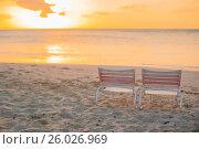 Купить «Two loungers on white sand beach on sunset lights», фото № 26026969, снято 8 апреля 2014 г. (c) Дмитрий Травников / Фотобанк Лори