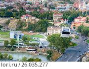 Купить «View on car of cableway under roofs of Old city Tbilisi, Georgia», фото № 26035277, снято 27 сентября 2016 г. (c) Elena Odareeva / Фотобанк Лори