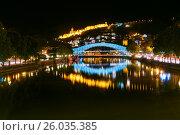 Купить «Bridge of Peace at night in Tibilisi, Georgia», фото № 26035385, снято 26 сентября 2016 г. (c) Elena Odareeva / Фотобанк Лори