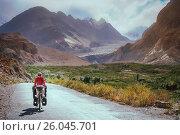 Купить «Cycling on Karakorum Highway», фото № 26045701, снято 20 сентября 2019 г. (c) easy Fotostock / Фотобанк Лори