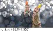 Купить «Happy couple blowing party horns against blur background», фото № 26047557, снято 11 декабря 2019 г. (c) Wavebreak Media / Фотобанк Лори