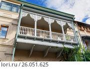 Купить «Carved wooden balcony in Tbilisi Georgia», фото № 26051625, снято 25 сентября 2016 г. (c) Elena Odareeva / Фотобанк Лори
