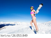 Купить «Sporty pretty girl holding skies behind her back», фото № 26053849, снято 23 декабря 2016 г. (c) Сергей Новиков / Фотобанк Лори
