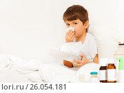 Купить «Sick boy sitting in bed and using paper napkins», фото № 26054181, снято 4 марта 2017 г. (c) Сергей Новиков / Фотобанк Лори