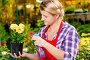 Girl gardener sprinkles flowers with water in the greenhouse, фото № 26054381, снято 15 июля 2016 г. (c) Константин Лабунский / Фотобанк Лори
