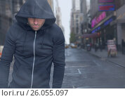 Купить «Criminal in hood in front of city street», фото № 26055097, снято 4 апреля 2020 г. (c) Wavebreak Media / Фотобанк Лори