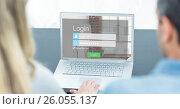 Man and woman looking at login screen on laptop. Стоковое фото, агентство Wavebreak Media / Фотобанк Лори