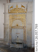 Купить «The Golden Fountain. The golden fountain (Mag-tooth) is made of marble and is located in a fountain courtyard near the entrance to the small Khan mosque. It was used for the ritual of ablution.», фото № 26057769, снято 1 августа 2014 г. (c) Акоп Васильян / Фотобанк Лори