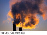 Купить «Emissions from plant pipe against setting sun», фото № 26059881, снято 30 марта 2017 г. (c) Михаил Коханчиков / Фотобанк Лори