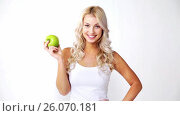 Купить «happy beautiful young woman with green apple», видеоролик № 26070181, снято 23 августа 2019 г. (c) Syda Productions / Фотобанк Лори