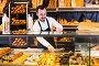 Seller offering fresh tasty bun, фото № 26077549, снято 26 января 2017 г. (c) Яков Филимонов / Фотобанк Лори