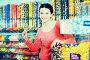 girl buying candies at shop, фото № 26077629, снято 22 марта 2017 г. (c) Яков Филимонов / Фотобанк Лори