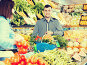 Glad seller helping customer to buy vegetables, фото № 26077681, снято 18 марта 2017 г. (c) Яков Филимонов / Фотобанк Лори