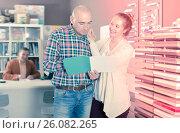 Купить «Smiling adult customers choosing kitchen facade», фото № 26082265, снято 4 апреля 2017 г. (c) Яков Филимонов / Фотобанк Лори