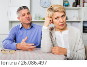 Купить «Mature couple decide family matters and find out relationship», фото № 26086497, снято 19 ноября 2018 г. (c) Яков Филимонов / Фотобанк Лори