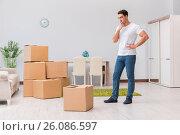 Купить «Man caryying boxes at home», фото № 26086597, снято 14 ноября 2016 г. (c) Elnur / Фотобанк Лори