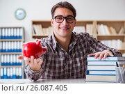 Купить «Student breaking piggybank to pay for tuition fees», фото № 26087405, снято 6 января 2017 г. (c) Elnur / Фотобанк Лори