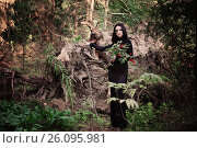 Купить «Beautiful witch posing in a mystic forest», фото № 26095981, снято 16 июля 2016 г. (c) Майя Крученкова / Фотобанк Лори