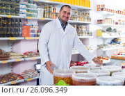 Купить «Shop staff standing near containers with olives in flavoured brine», фото № 26096349, снято 15 октября 2016 г. (c) Яков Филимонов / Фотобанк Лори