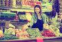 Woman seller displaying assortment, фото № 26096481, снято 18 марта 2017 г. (c) Яков Филимонов / Фотобанк Лори