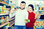 Couple standing near shelves with canned goods at store, фото № 26096513, снято 14 марта 2017 г. (c) Яков Филимонов / Фотобанк Лори