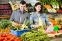 Young attentive couple choosing vegetables in grocery shop, фото № 26096529, снято 18 марта 2017 г. (c) Яков Филимонов / Фотобанк Лори