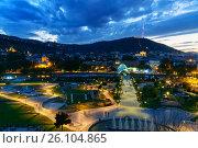Купить «View of Rike Park with Bridge of Peace at night. Tbilisi, Georgia», фото № 26104865, снято 26 сентября 2016 г. (c) Elena Odareeva / Фотобанк Лори