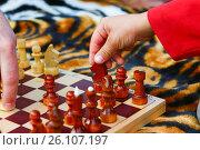 Купить «Child's hand takes a chess piece», фото № 26107197, снято 15 августа 2009 г. (c) Анна Гучек / Фотобанк Лори