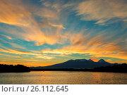 Beautiful sunrise over volcanoes Kluchevskaya group with reflection in the river Kamchatka. Стоковое фото, фотограф Zoonar/yykkaa / easy Fotostock / Фотобанк Лори