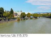 Купить «View bank of Kura river with Public Service Hall», фото № 26115373, снято 22 сентября 2016 г. (c) Elena Odareeva / Фотобанк Лори