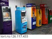 Купить «Ряд разноцветных банкоматов в аэропорту Пхукета», фото № 26117433, снято 10 января 2017 г. (c) Chere / Фотобанк Лори