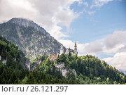 Купить «Neuschwanstein castle in Bavaria, Germany. Beautiful and famous landmark.», фото № 26121297, снято 6 июня 2016 г. (c) Юрий Дмитриенко / Фотобанк Лори