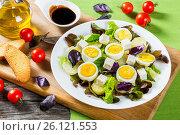 Potato salad with chicken eggs, lettuce leaves, cheese, basil. Стоковое фото, фотограф Oksana Zh / Фотобанк Лори