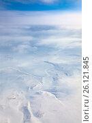Купить «Облака над зимней тундрой, вид сверху», фото № 26121845, снято 3 апреля 2017 г. (c) Владимир Мельников / Фотобанк Лори