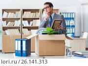 Купить «Man moving office with box and his belongings», фото № 26141313, снято 11 ноября 2016 г. (c) Elnur / Фотобанк Лори